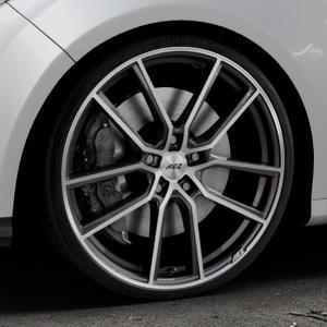 AEZ Raise Gunmetal polished Felge mit Reifen grau silber mehrfarbig in 20Zoll Alufelge auf silbernem Ford Focus III Typ DYB (Schrägheck) (Stufenheck) Facelift ⬇️ mit 15mm Tieferlegung ⬇️ Industriehalle 1 Thumbnail