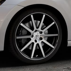 AEZ Straight Black/polished front Felge mit Reifen silber schwarz mehrfarbig in 18Zoll Alufelge auf silbernem Volkswagen (VW) Golf 7 Sportsvan ⬇️ mit 15mm Tieferlegung ⬇️ Industriehalle 1 Thumbnail