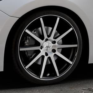 AEZ Straight Black/polished front Felge mit Reifen silber schwarz mehrfarbig in 19Zoll Alufelge auf silbernem Mazda 3 (13-) Stufenheck (BM) Sport (17-) Facelift Fließheck ⬇️ mit 15mm Tieferlegung ⬇️ Industriehalle 1 Thumbnail