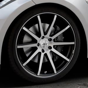 AEZ Straight Black/polished front Felge mit Reifen silber schwarz mehrfarbig in 20Zoll Alufelge auf silbernem Tesla Model S Typ 002 ⬇️ mit 15mm Tieferlegung ⬇️ Industriehalle 1 Thumbnail