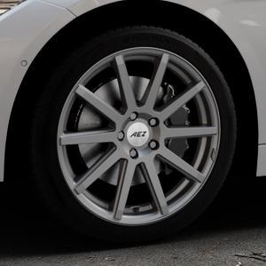 AEZ Straight Graphite matt Felge mit Reifen grau in 18Zoll Winterfelge Alufelge auf silbernem BMW 320i Typ F30 (Limousine) 328i 335i 320d 318d 316d 316i 330d xDrive EffDyn Edition 325d 335d ActiveHybrid 318i ⬇️ mit 15mm Tieferlegung ⬇️ Industriehalle 1 Thumbnail