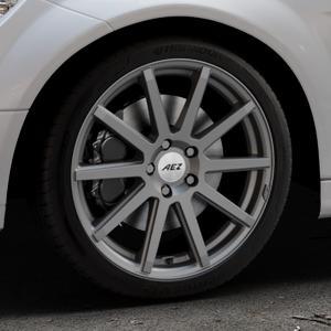 AEZ Straight Graphite matt Felge mit Reifen grau in 18Zoll Winterfelge Alufelge auf silbernem Mercedes C-Klasse Typ W204 Limousine ⬇️ mit 15mm Tieferlegung ⬇️ Industriehalle 1 Thumbnail