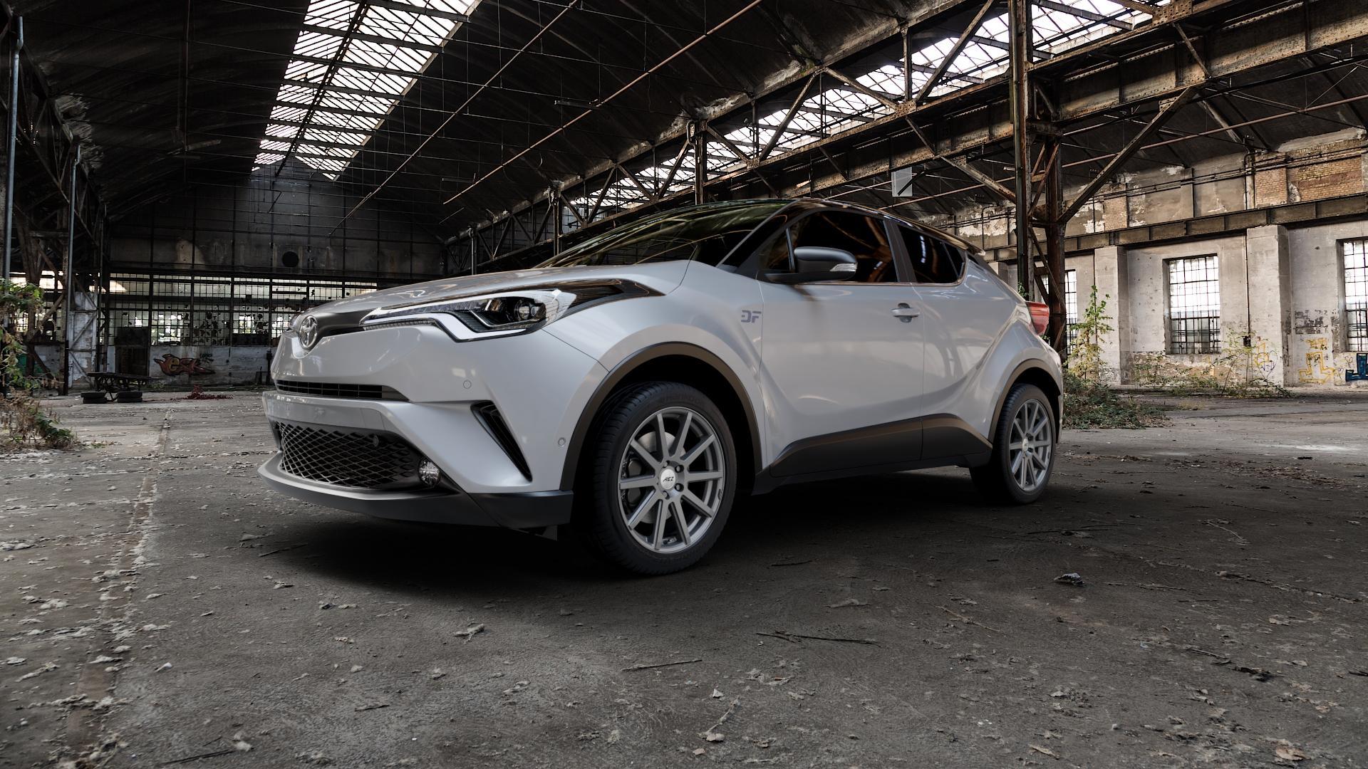 AEZ Straight Graphite matt Felge mit Reifen grau in 18Zoll Winterfelge Alufelge auf silbernem Toyota C-HR Typ AX1T(EU,M) AX1T(EU,M)-TMG ⬇️ mit 15mm Tieferlegung ⬇️ Industriehalle 1 Camera_000