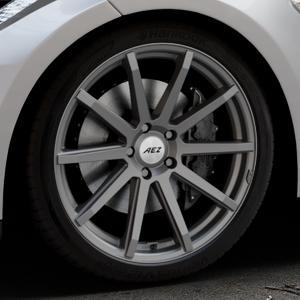 AEZ Straight Graphite matt Felge mit Reifen grau in 20Zoll Winterfelge Alufelge auf silbernem Tesla Model S Typ 002 ⬇️ mit 15mm Tieferlegung ⬇️ Industriehalle 1 Thumbnail