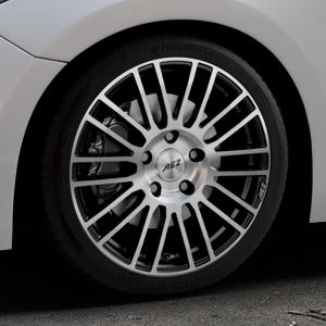 AEZ Strike Black/polished front Felge mit Reifen silber schwarz mehrfarbig in 18Zoll Alufelge auf silbernem Mazda 3 (13-) Stufenheck (BM) Sport (17-) Facelift Fließheck ⬇️ mit 15mm Tieferlegung ⬇️ Industriehalle 1 Thumbnail