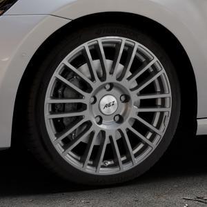 AEZ Strike Graphite matt Felge mit Reifen grau in 18Zoll Winterfelge Alufelge auf silbernem Volkswagen (VW) Golf 7 Sportsvan ⬇️ mit 15mm Tieferlegung ⬇️ Industriehalle 1 Thumbnail