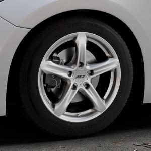 AEZ Yacht High gloss Felge mit Reifen silber in 16Zoll Winterfelge Alufelge auf silbernem Mazda 3 (13-) Stufenheck (BM) Sport (17-) Facelift Fließheck ⬇️ mit 15mm Tieferlegung ⬇️ Industriehalle 1 Thumbnail