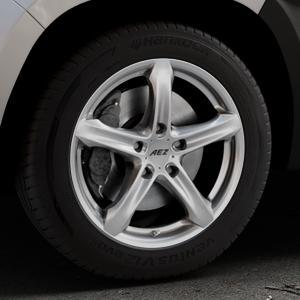 AEZ Yacht High gloss Felge mit Reifen silber in 17Zoll Winterfelge Alufelge auf silbernem Dacia Duster Typ SR ⬇️ mit 15mm Tieferlegung ⬇️ Industriehalle 1 Thumbnail
