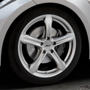 AEZ Yacht High gloss Felge mit Reifen silber in 19Zoll Winterfelge Alufelge auf silbernem Tesla Model S Typ 002 ⬇️ mit 15mm Tieferlegung ⬇️ Industriehalle 1 Thumbnail
