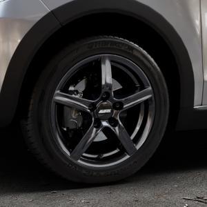ALUTEC Grip graphit Felge mit Reifen grau in 15Zoll Winterfelge Alufelge auf silbernem Volkswagen (VW) UP Cross ⬇️ mit 15mm Tieferlegung ⬇️ Industriehalle 1 Thumbnail