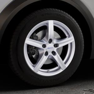 ALUTEC Grip polar-silber Felge mit Reifen in 16Zoll Winterfelge Alufelge auf silbernem Mazda CX-3 Typ DJ1 ⬇️ mit 15mm Tieferlegung ⬇️ Industriehalle 1 Thumbnail