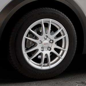 ALUTEC Monstr polar-silber Felge mit Reifen in 16Zoll Winterfelge Alufelge auf silbernem Mazda CX-3 Typ DJ1 ⬇️ mit 15mm Tieferlegung ⬇️ Industriehalle 1 Thumbnail
