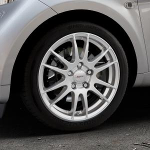 ALUTEC Monstr polar-silber Felge mit Reifen in 16Zoll Winterfelge Alufelge auf silbernem Smart Fortwo Coupe III (14-) (453) Cabrio (16-) ⬇️ mit 15mm Tieferlegung ⬇️ Industriehalle 1 Thumbnail