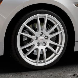 ALUTEC Monstr polar-silber Felge mit Reifen in 18Zoll Winterfelge Alufelge auf silbernem Fiat 124 Spider Typ NF ⬇️ mit 15mm Tieferlegung ⬇️ Industriehalle 1 Thumbnail