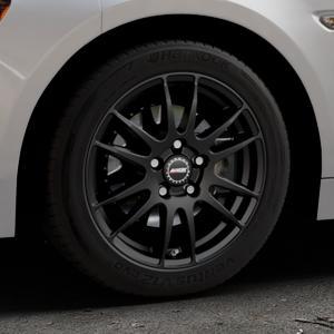 ALUTEC Monstr racing-schwarz Felge mit Reifen in 16Zoll Winterfelge Alufelge auf silbernem Fiat 124 Spider Typ NF ⬇️ mit 15mm Tieferlegung ⬇️ Industriehalle 1 Thumbnail