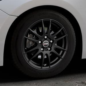 ALUTEC Monstr racing-schwarz Felge mit Reifen in 16Zoll Winterfelge Alufelge auf silbernem Mazda 3 (13-) Stufenheck (BM) Sport (17-) Facelift Fließheck ⬇️ mit 15mm Tieferlegung ⬇️ Industriehalle 1 Thumbnail
