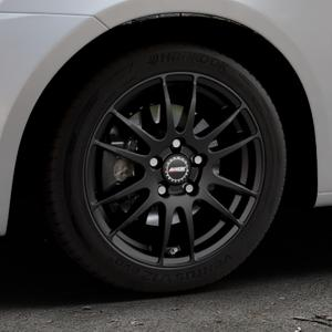 ALUTEC Monstr racing-schwarz Felge mit Reifen in 16Zoll Winterfelge Alufelge auf silbernem Suzuki Swift V Typ NZ FZ ⬇️ mit 15mm Tieferlegung ⬇️ Industriehalle 1 Thumbnail