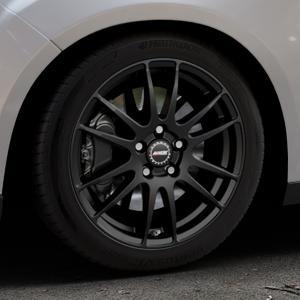 ALUTEC Monstr racing-schwarz Felge mit Reifen in 17Zoll Winterfelge Alufelge auf silbernem Ford Focus III Typ DYB Facelift (Schrägheck) ⬇️ mit 15mm Tieferlegung ⬇️ Industriehalle 1 Thumbnail