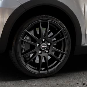 ALUTEC Monstr racing-schwarz Felge mit Reifen in 17Zoll Winterfelge Alufelge auf silbernem Volkswagen (VW) UP Cross ⬇️ mit 15mm Tieferlegung ⬇️ Industriehalle 1 Thumbnail