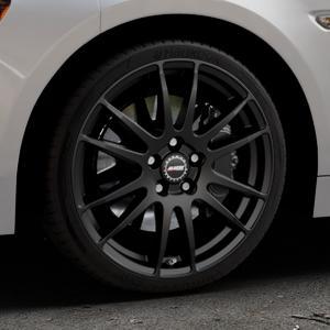 ALUTEC Monstr racing-schwarz Felge mit Reifen in 18Zoll Winterfelge Alufelge auf silbernem Fiat 124 Spider Typ NF ⬇️ mit 15mm Tieferlegung ⬇️ Industriehalle 1 Thumbnail
