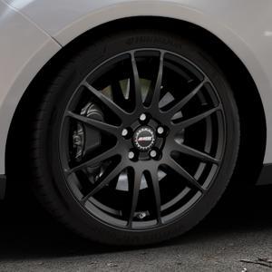 ALUTEC Monstr racing-schwarz Felge mit Reifen in 18Zoll Winterfelge Alufelge auf silbernem Ford Focus III Typ DYB Facelift (Turnier) ⬇️ mit 15mm Tieferlegung ⬇️ Industriehalle 1 Thumbnail