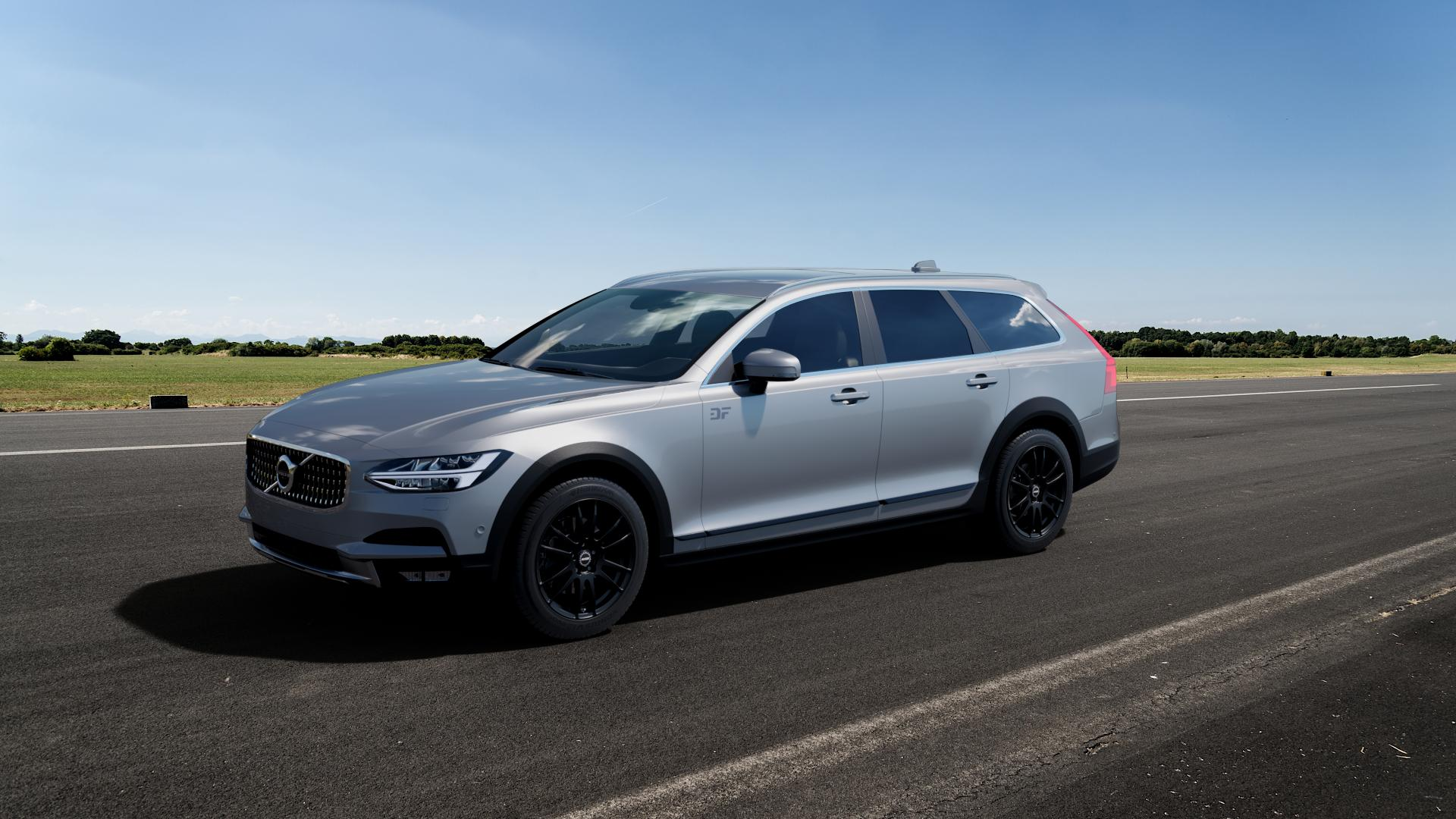 ALUTEC Monstr racing-schwarz Felge mit Reifen in 18Zoll Winterfelge Alufelge auf silbernem Volvo V90 II Cross Country Typ P ⬇️ mit 15mm Tieferlegung ⬇️ Big_Vehicle_Airstrip_1 Frontansicht_1