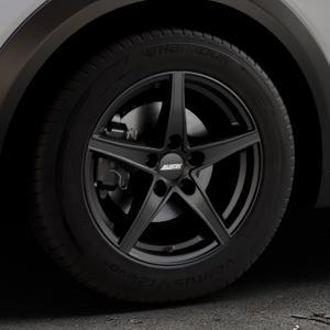 ALUTEC Raptr racing-schwarz Felge mit Reifen in 16Zoll Winterfelge Alufelge auf silbernem Mazda CX-3 Typ DJ1 ⬇️ mit 15mm Tieferlegung ⬇️ Industriehalle 1 Thumbnail