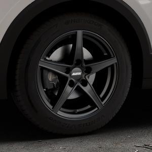 ALUTEC Raptr racing-schwarz Felge mit Reifen in 16Zoll Winterfelge Alufelge auf silbernem Volkswagen (VW) T-Cross ⬇️ mit 15mm Tieferlegung ⬇️ Industriehalle 1 Thumbnail