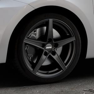 ALUTEC Raptr racing-schwarz Felge mit Reifen in 17Zoll Winterfelge Alufelge auf silbernem Suzuki Swift VI Typ AZ ⬇️ mit 15mm Tieferlegung ⬇️ Industriehalle 1 Thumbnail