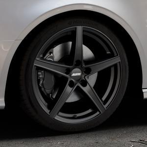 ALUTEC Raptr racing-schwarz Felge mit Reifen in 18Zoll Winterfelge Alufelge auf silbernem Audi A3 Typ 8V (Cabriolet) ⬇️ mit 15mm Tieferlegung ⬇️ Industriehalle 1 Thumbnail