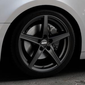 ALUTEC Raptr racing-schwarz Felge mit Reifen in 18Zoll Winterfelge Alufelge auf silbernem Audi A4 Typ B9 (Avant) ⬇️ mit 15mm Tieferlegung ⬇️ Industriehalle 1 Thumbnail