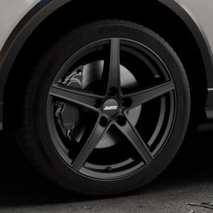 ALUTEC Raptr racing-schwarz Felge mit Reifen in 18Zoll Winterfelge Alufelge auf silbernem Audi Q2 Typ GA ⬇️ mit 15mm Tieferlegung ⬇️ Industriehalle 1 Thumbnail