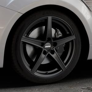 ALUTEC Raptr racing-schwarz Felge mit Reifen in 18Zoll Winterfelge Alufelge auf silbernem Ford Focus II Typ DA3 (Schrägheck) 2,5l RS 224kW (305 PS) RS500 257kW (349 ⬇️ mit 15mm Tieferlegung ⬇️ Industriehalle 1 Thumbnail