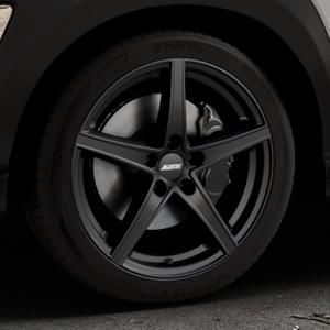 ALUTEC Raptr racing-schwarz Felge mit Reifen in 18Zoll Winterfelge Alufelge auf silbernem Hyundai Kona Typ OS ⬇️ mit 15mm Tieferlegung ⬇️ Industriehalle 1 Thumbnail