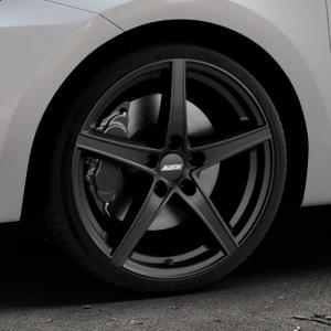 ALUTEC Raptr racing-schwarz Felge mit Reifen in 18Zoll Winterfelge Alufelge auf silbernem Suzuki Swift VI Typ AZ ⬇️ mit 15mm Tieferlegung ⬇️ Industriehalle 1 Thumbnail