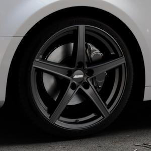 ALUTEC Raptr racing-schwarz Felge mit Reifen in 19Zoll Winterfelge Alufelge auf silbernem Audi A4 Typ B9 (Limousine) ⬇️ mit 15mm Tieferlegung ⬇️ Industriehalle 1 Thumbnail