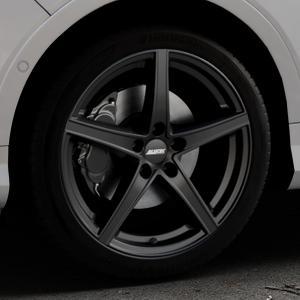 ALUTEC Raptr racing-schwarz Felge mit Reifen in 19Zoll Winterfelge Alufelge auf silbernem Ford Kuga II Facelift (15->) (17->) ⬇️ mit 15mm Tieferlegung ⬇️ Industriehalle 1 Thumbnail