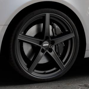 ALUTEC Raptr racing-schwarz Felge mit Reifen in 20Zoll Winterfelge Alufelge auf silbernem Audi A6 Typ 4F/C6 (Limousine) ⬇️ mit 15mm Tieferlegung ⬇️ Industriehalle 1 Thumbnail