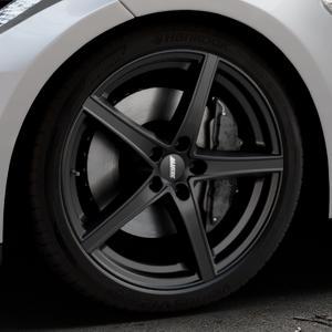 ALUTEC Raptr racing-schwarz Felge mit Reifen in 20Zoll Winterfelge Alufelge auf silbernem Tesla Model S Typ 002 ⬇️ mit 15mm Tieferlegung ⬇️ Industriehalle 1 Thumbnail