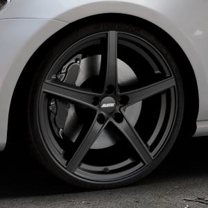 ALUTEC Raptr racing-schwarz Felge mit Reifen in 20Zoll Winterfelge Alufelge auf silbernem Volkswagen (VW) Golf 7 ⬇️ mit 15mm Tieferlegung ⬇️ Industriehalle 1 Thumbnail