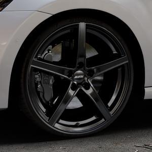 ALUTEC Raptr racing-schwarz Felge mit Reifen in 20Zoll Winterfelge Alufelge auf silbernem Volkswagen (VW) Golf 7 Sportsvan ⬇️ mit 15mm Tieferlegung ⬇️ Industriehalle 1 Thumbnail