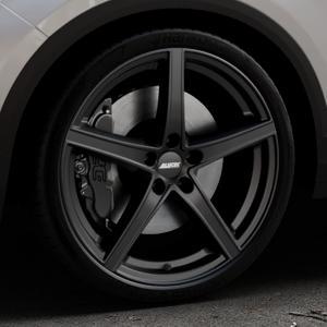 ALUTEC Raptr racing-schwarz Felge mit Reifen in 20Zoll Winterfelge Alufelge auf silbernem Volkswagen (VW) T-Roc ⬇️ mit 15mm Tieferlegung ⬇️ Industriehalle 1 Thumbnail