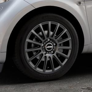 AUTEC Fanatic Schwarz matt Felge mit Reifen in 15Zoll Winterfelge Alufelge auf silbernem Smart Fortwo Coupe III (14-) (453) Cabrio (16-) ⬇️ mit 15mm Tieferlegung ⬇️ Industriehalle 1 Thumbnail