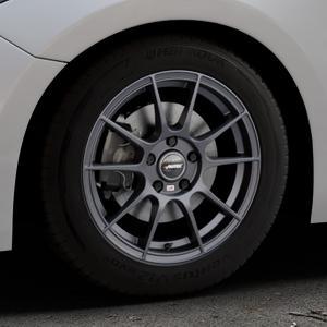 AUTEC Wizard Gunmetal matt Felge mit Reifen grau in 16Zoll Winterfelge Alufelge auf silbernem Mazda 3 (13-) Stufenheck (BM) Sport (17-) Facelift Fließheck ⬇️ mit 15mm Tieferlegung ⬇️ Industriehalle 1 Thumbnail