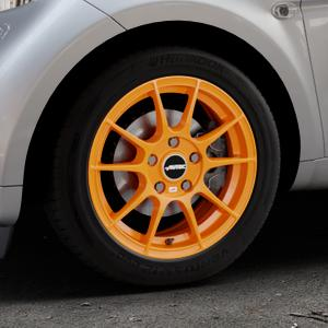 AUTEC Wizard Racing orange Felge mit Reifen in 15Zoll Winterfelge Alufelge auf silbernem Smart Fortwo Coupe III (14-) (453) Cabrio (16-) ⬇️ mit 15mm Tieferlegung ⬇️ Industriehalle 1 Thumbnail