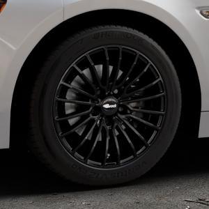 Brock B24 schwarz lackiert Felge mit Reifen in 16Zoll Winterfelge Alufelge auf silbernem Fiat 124 Spider Typ NF ⬇️ mit 15mm Tieferlegung ⬇️ Industriehalle 1 Thumbnail