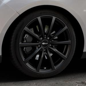 Brock B32 schwarz-matt lackiert Felge mit Reifen in 18Zoll Winterfelge Alufelge auf silbernem Ford Focus III Typ DYB Facelift (Turnier) ⬇️ mit 15mm Tieferlegung ⬇️ Industriehalle 1 Thumbnail