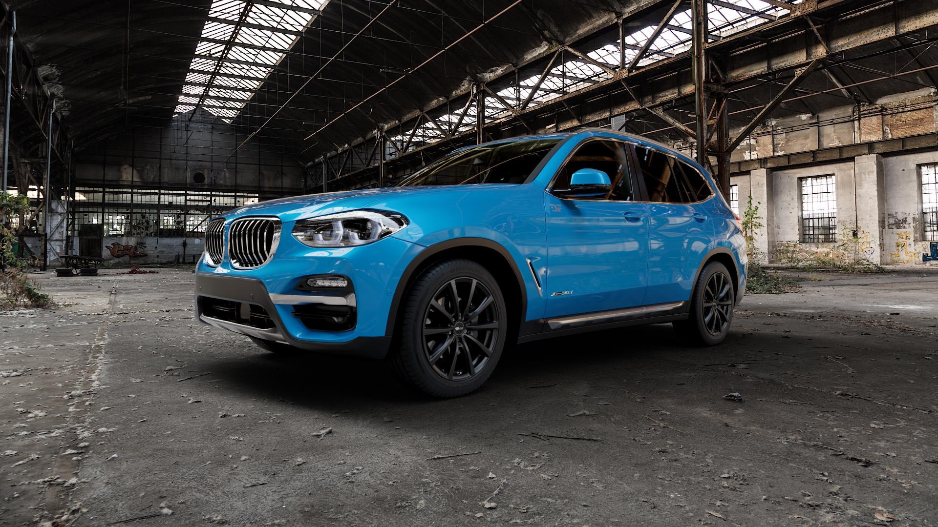 Brock B32 schwarz-matt lackiert Felge mit Reifen in 19Zoll Winterfelge Alufelge auf hellblau BMW X3 Typ G01 (G3X) ⬇️ mit 15mm Tieferlegung ⬇️ Industriehalle 1 Camera_000