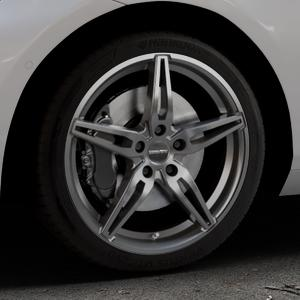 CARMANI 15 Oskar hyper gun Felge mit Reifen silber in 18Zoll Winterfelge Alufelge auf silbernem BMW 214d Typ F2AT (F45 Active Tourer) 216d 216i 218d 218i 220d xDrive 220i 225i 225xe ⬇️ mit 15mm Tieferlegung ⬇️ Industriehalle 1 Thumbnail