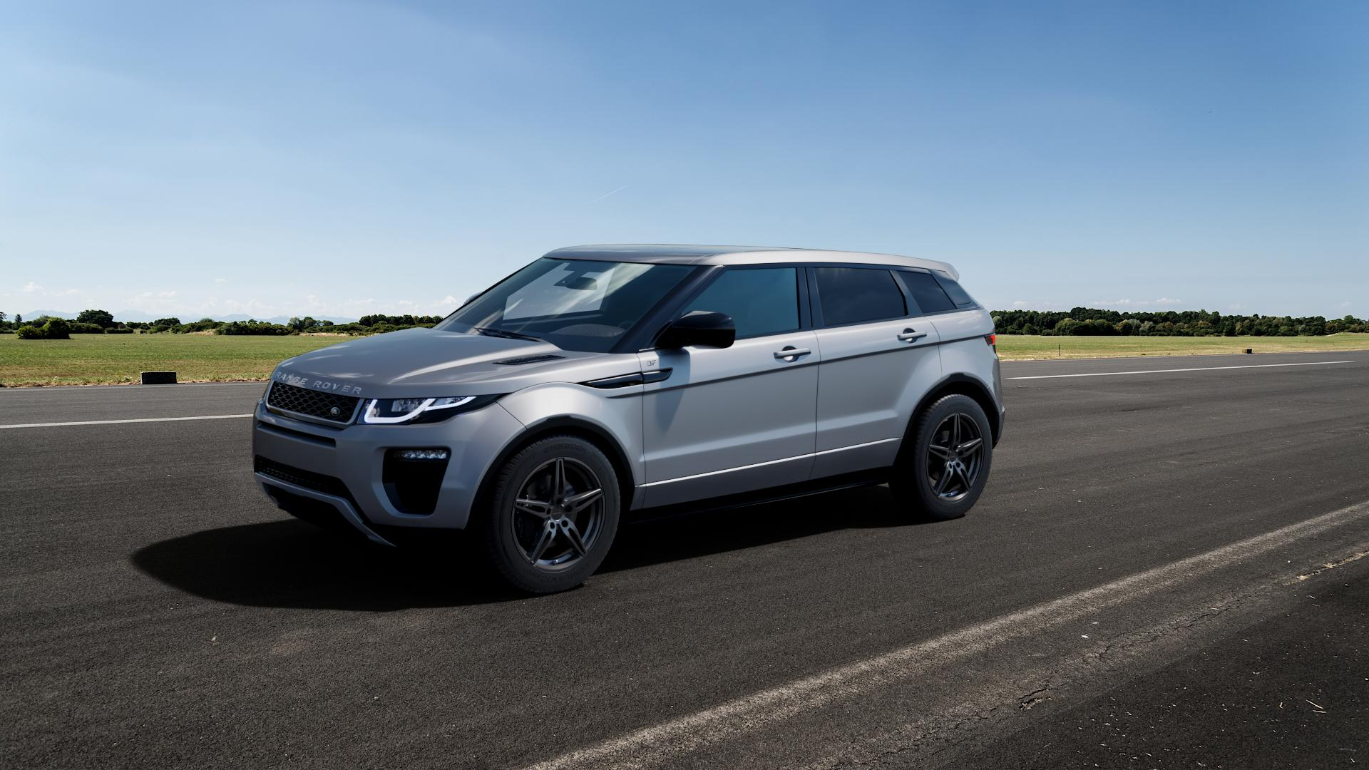 CARMANI 15 Oskar hyper gun Felge mit Reifen silber in 18Zoll Winterfelge Alufelge auf silbernem Land Rover Range Evoque Typ LV Facelift ⬇️ mit 15mm Tieferlegung ⬇️ Big_Vehicle_Airstrip_1 Frontansicht_1